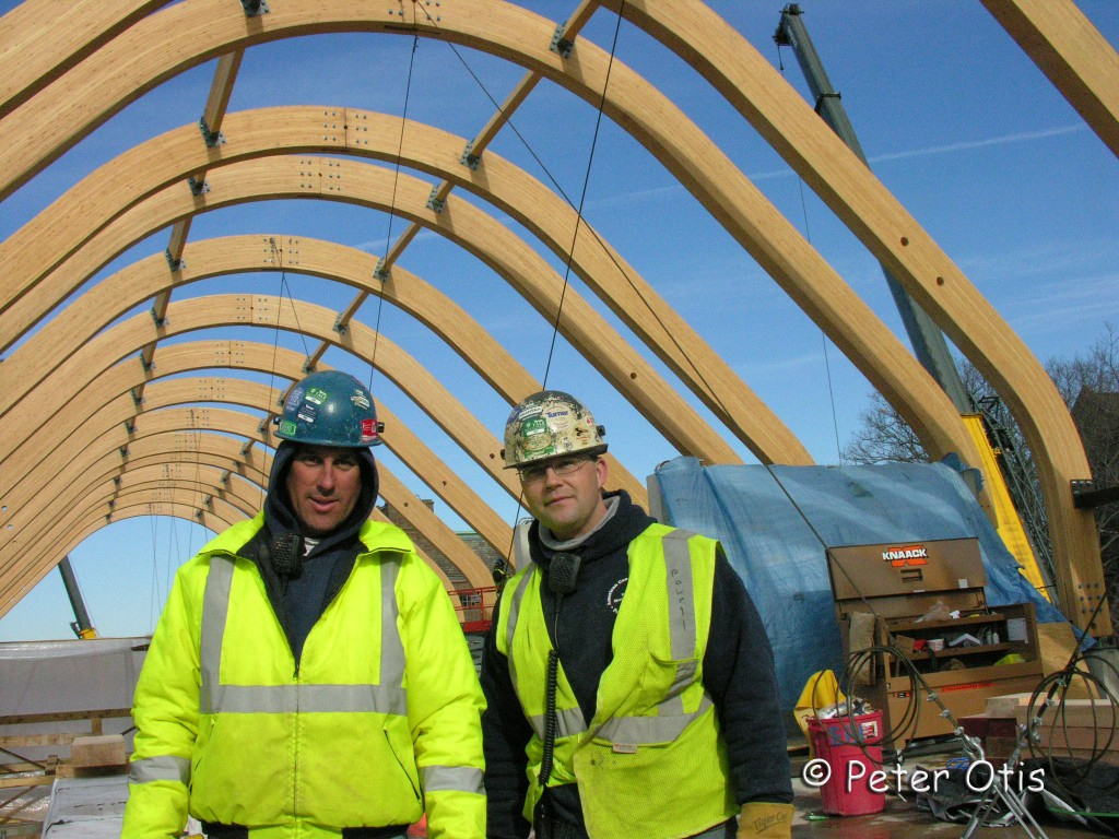 AN EARLY INTERIOR SHOT Finally, with trusses in place, we could sense what the building's form would look like. Two of Epifano's workers Jesse and Ed are shown here.