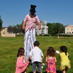 Dic Wheeler, Executive Director of ARTFARM in Middletown - stilter- with kids