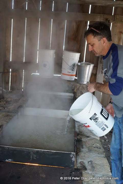 Dudley Farm- George Page adding more sap to the boiling pan